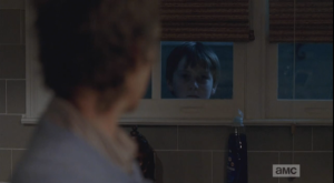 As Carol struggles to find the words, a little face peers in the window...it's Sam. He looks at Carol through the window.