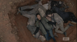 ...and the shot pans out as Sasha closes her eyes, opens her arms, and surrenders to the strange peace of lying on top of the fallen walkers.