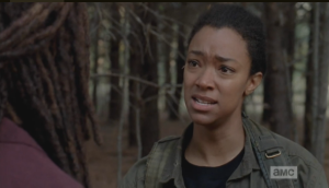 Sasha looks miserably at Michonne.