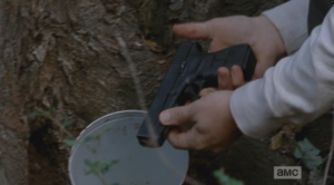 It seems that Rick Grimes isn't the only one stashing guns around these woods! (This couldn't be Rick's gun, could it?)
