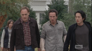 Tobin, Nicholas, and Glenn take a step towards Rick, and then back away quickly...