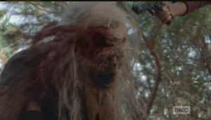 Sasha is having a hard time getting her knife, which lay just out of reach above her head, so Michonne steps up and rekills White Walker, executioner style. Buh bye, While Walker.