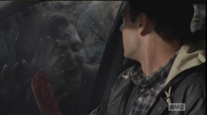 As Daryl counts, Aaron, gripping his machete, turns and locks eyes with one of the walkers, outside. The walker seems to be smiling at Aaron, as if it knows what is happening...