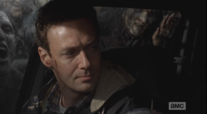 Aaron looks over at Daryl.