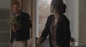 Abraham comes in, bearing flowers, to visit Tara...