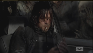 After a moment, Daryl pulls out a cigarette, puts it in his mouth, and reaches in his jacket, fishing for a light.