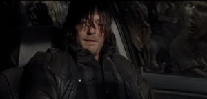 Daryl looks towards Aaron, then slightly away as he marvels,