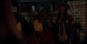 Michonne looks around at the assembled Alexandrians, then at Deanna Monroe.