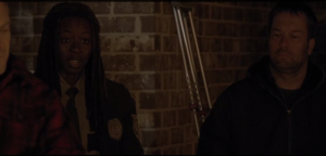 Michonne speaks up, says archly,