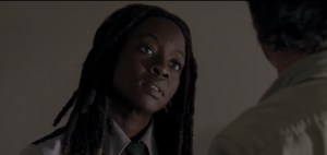 Michonne looks up at Rick, looking like The Most Beautiful Wise One (and you know that's a Deadie, and you know it goes to Michonne/Danai Gurira! <3).