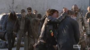 ...as Daryl stabs at the walkers, and Morgan takes them out with his staff. Between the three of them, they are able to clear a line to the gate and quickly get outside, pulling the gate closed behind them, barring the walkers' way.