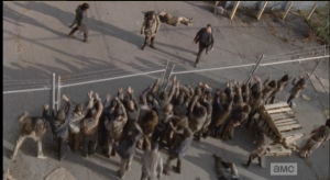 As the walkers rush the fence,  Aaron, Daryl, and Morgan take a moment to process the fact that they just escaped, against all odds. They made it!