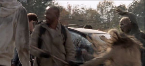 Brandishing his trusty wooden staff, Morgan continues taking out walkers, buying Aaron and Daryl a moment to get out of the car and begin battling walkers themselves.