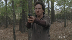 Nicholas is running through the woods, buggin' hard, trying to find Glenn, who he shot, and lost...he sees a figure moving through the trees, raises his gun.