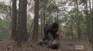 ...and manages to stomp the inside of one of Nicholas's legs, hard, most likely breaking the bone. Nicholas gets the advantage once again, ending up on top of Glenn, punching him again and again, jabbing poor Glenn's wound. Glenn screams out in pain.