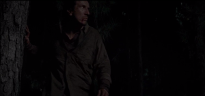 We see Nicholas, limping through the trees...a noise behind him startles him...