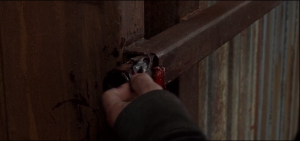 ...blood and gory bits left on the slide-latch part of the gate...Rick looks down at the ground, sees drops of blood in a line leading into Alexandria.