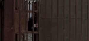 Rick quickly pulls the gate closed, latches it locked, and turns to scour the streets of Alexandria...