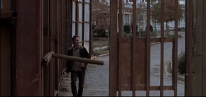 Outside, Rick walks quickly towards the gate, which is open...he checks all around the fence, peers outside, then sees...