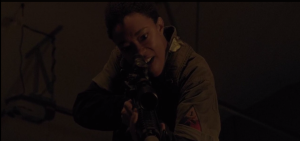 Sasha points the rifle at Gabriel, but cannot bring herself to pull the trigger.