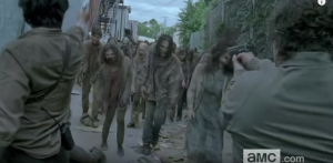 It looks like Glenn and Nicholas are holding the line, together, against a huge rush of walkers...inside Alexandria!
