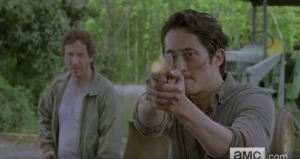 ...and we see Glenn, flanked by Nicholas, standing his ground and firing a gun...hopefully, Nicholas and Glenn have set aside their differences and are working together these days.