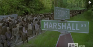(...especially as we see, in the next shot, a huge horde of walkers, spanning the length of the road, making their way down Reading