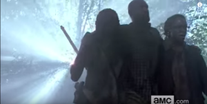 ...but I am not sure who this other guy is. Either Gabriel's been working out, or there's a hot dude that's looking pretty great on Michonne's arm...