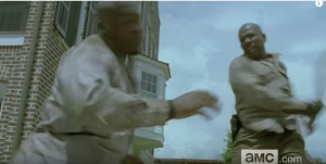 TWD fan theorists also echoed my suspicions that this individual who Morgan is smacking the fuck down looks more like a live person than a walker...a live member of the Wolves, perhaps. It is also being suggested that Morgan's