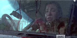 ...probably someone from Enid's family, while the poor girl must watch from the safety of a locked car or truck.