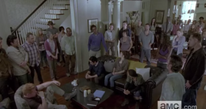 Among the faces in the group, we see familiar ones from our sweet gang, as well as Alexandrians we recognize, as well as ones we have yet to meet...many of those assembled are looking down, or at Rick, digesting whatever information, or plan, he is presenting.
