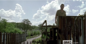 We see Rick survey the view of the outside world beyond the walls of Alexandria's lookout...