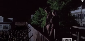 We see another shot of Rosita and Spencer, on lookout at the wall...is this a becoming a thing, Rosita and Spencer? Because that would be weird...