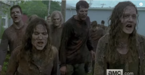 We see a sizeable group of walkers charge forward, teeth bared...