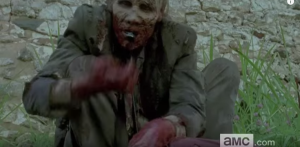 We see yet another horrible image of a walker feasting on some poor somebody...