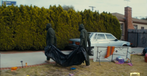 In the next shot, we see military in full-protective clothing carrying off the sad remains of the Cruzes.