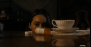 And as she rises to leave, she sees a disturbing sight on the table in front of her...an empty bottle of prescription pills, next to an elegant tea cup and saucer.