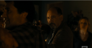 Daniel Salazar appears, takes the gun from Madison, and orders Travis to stand back.