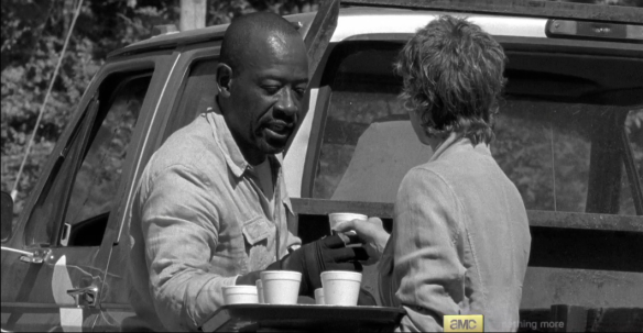 Back in time, back at the construction site, Carol offers Morgan a cup of water, which he accepts with a thanks.