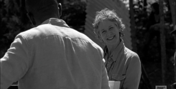 Carol turns back to Morgan, her forced smile even bigger.