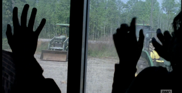 Glenn, Nicholas, and Heath have reached the tractor store, without a moment to spare. If they are too late, the noise of the tractors could distract the walker parade off the road. They must act fast.