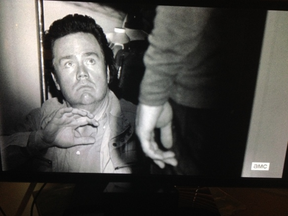 In true Josh McDermitt comedic timing and delivery, Eugene looks up at Carter, says,