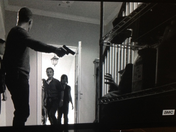 Just then, the door opens, and there stands Rick Grimes, flanked by Daryl and Morgan.