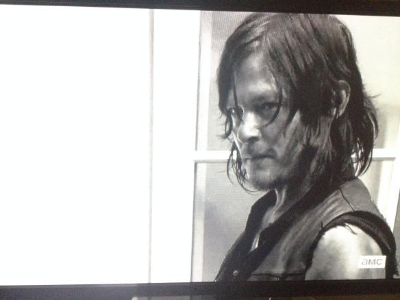 Daryl looks up at Rick.