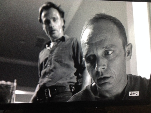 Rick looks down at Carter, who seems like he can't believe he's still alive.