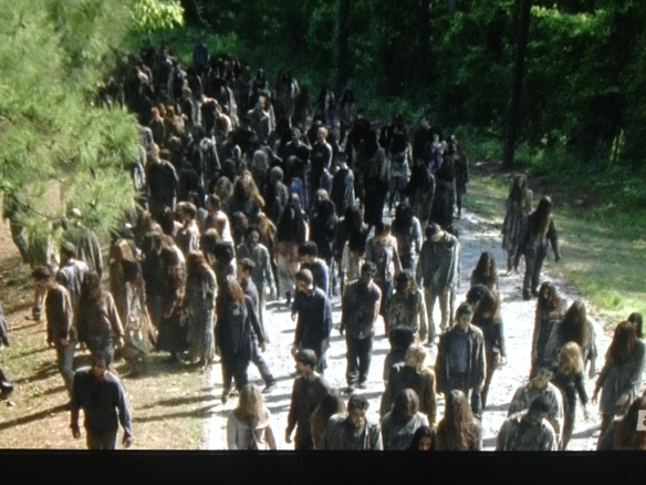 The horde of walkers begins to follow the sound of the screams...