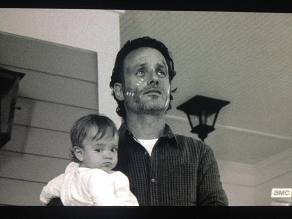 Rick comes out, carrying Judith, and he and Morgan remark about the lovely evening.