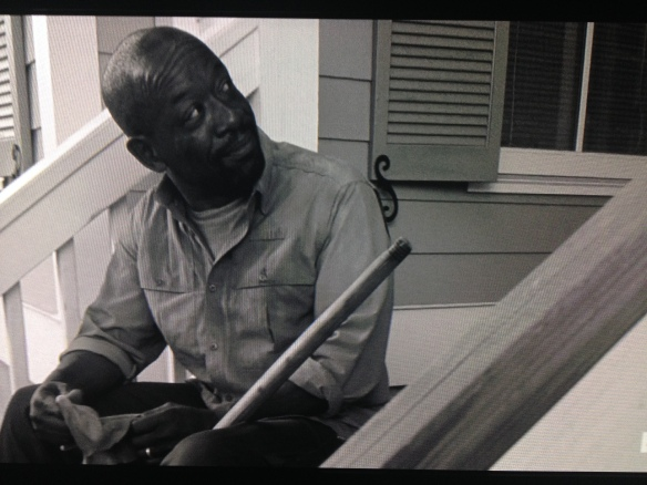 Morgan looks at Rick, pleased. He then looks at Judith, which Rick notices.