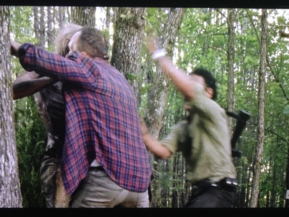 Rick reaches poor Carter, and manages to pry him off the tree walker.
