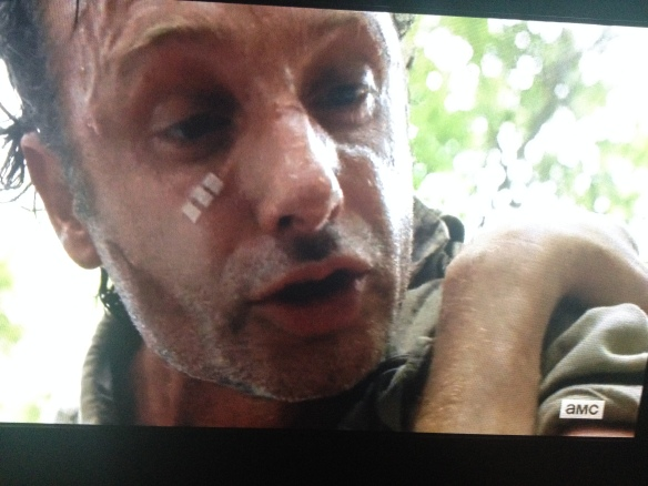To his credit, Rick Grimes tries to calm him, but to no avail, of course.